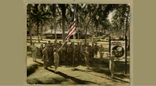 The 57th Naval Construction Battalion hoists the U.S. flag at 0800 for morning colors on Espiritu Santo, circa 1943.