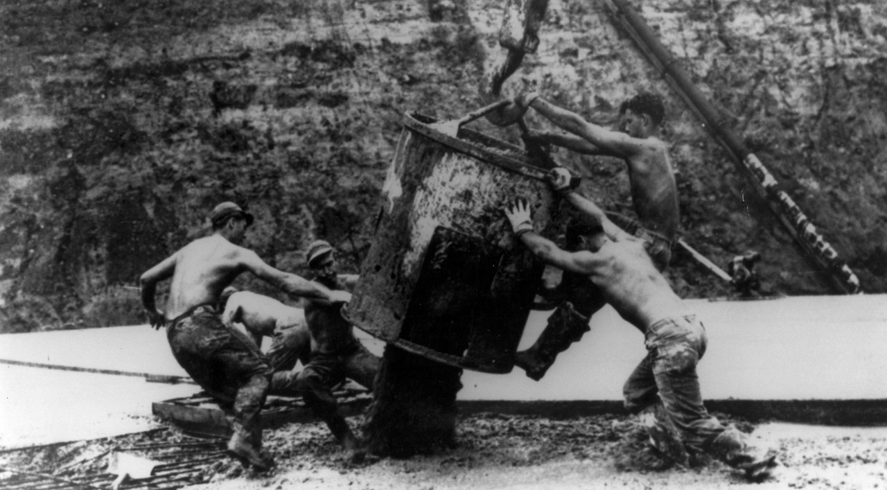 Seabees unload concrete bucket at Cubi Point. Iconic image of Seabees unloading concrete bucket at Cubi Point naval base, circa early 1950s.