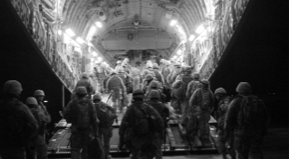 Seabees assigned to Naval Mobile Construction Battalion (NMCB) 17 board an Air Force C-17 aircraft in Kuwait, bound for Anbar Province, Iraq, 19 March 2008.
