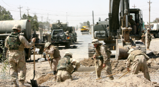 Seabees with NMCB-40 prepare a site for the construction of a bridge, Fallujah, Iraq, 16 June 2006.