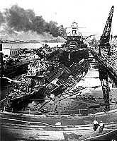 Wrecked destroyers USS Downes and USS Cassin in dry-dock for repairs