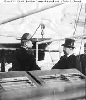 President Theodore Roosevelt (right) shakes hands with Lieutenant Walter R. Gherardi, Commanding Officer, Yankton, 16 December 1907.