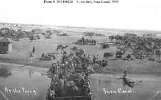 View of camel caravan at canal ferry crossing, taken from one of fleet's battleships during transit of Suez Canal, January 1909.