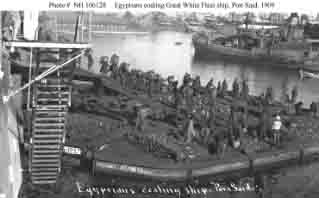 Local workers coaling one of fleet's battleships at Port Said, Egypt, following January 1909 Suez Canal transit.