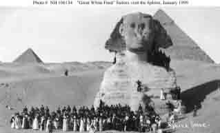 Sailors pose at the Sphinx with their guides during sightseeing tour to Giza, Egypt, January 1909.