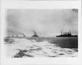 Atlantic Fleet cruisers steam in column as they welcome the Great White Fleet upon its return to Hampton Roads, Virginia, 22 February 1909.