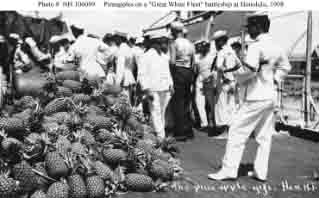 Pineapples piled on a battleship's deck during visit to Honolulu, July 1908.