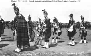Scotch bagpipers and bandsmen at ceremony during fleet's visit to Sydney, New South Wales, Australia, August 1908.