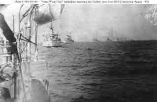 Fleet battleships steaming in column while entering Sydney harbor, Australia, 20 August 1908.