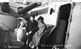 U.S. Navy Chief Machinist's Mate poses with Japanese lady on a battleship's deck during fleet's visit to Yokohama, Japan, October 1908.