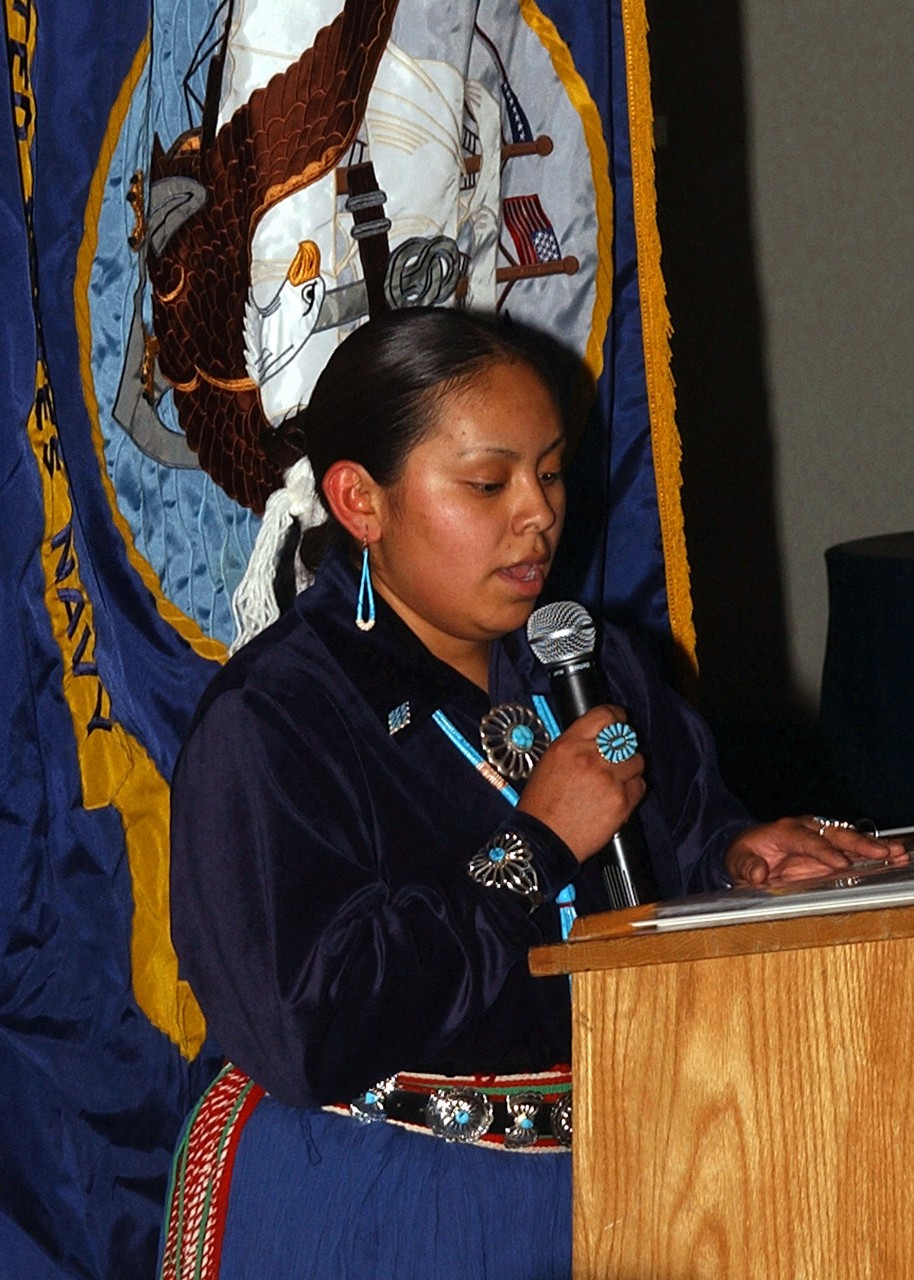 041130-N-6125G-015:   Native American and Alaskan Native Heritage Month, November 2004. Fireman Apprentice Andrea Barney says a Navajo prayer to start off Native American and Alaskan Native Heritage Month celebration on board USS Harry S. Truman (CVN-75) while in the Persian Gulf.  Truman's Carrier Strike Group Ten (CSG-10) and embarked Carrier Air Wing Three is currently on a regularly scheduled deployment in support of the Global War On Terrorism.  Photographed by Photographer's Mate Airman Eric S. Garst.  Official U.S. Navy Photograph.