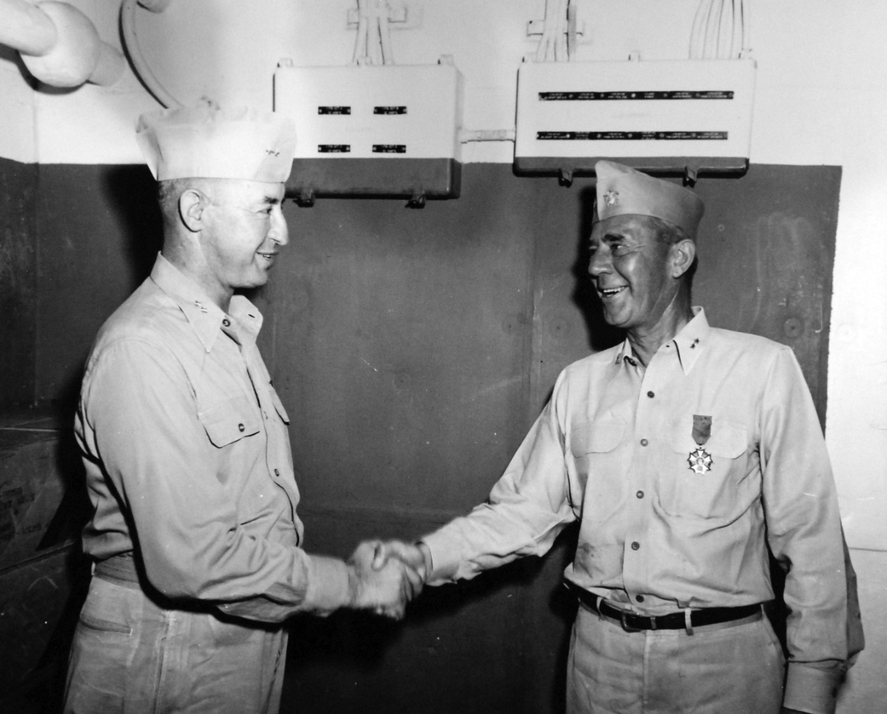 80-G-367404:   Rear Admiral Joseph J. Clark, 1945.    USS Hornet (CV-12).  Admiral Joseph J. Clark presents Legion of Merit to Rear Admiral Lloyd J. Wiltse, CO Cruiser-Division 10 (part of Task Force 58.1), May 3, 1945.   Official U.S. Navy Photograph, now in the collections of the National Archives.
