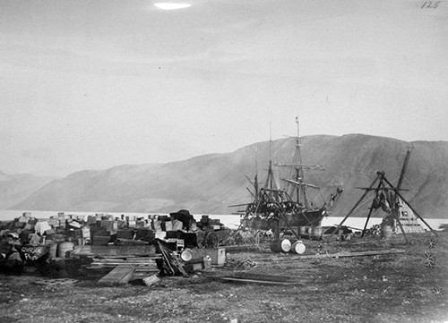 LC-USZ62-17183:  Lady Franklin Bay Expedition, 1881-84, led by Lieutenant Adolphus Greely.  The Expedition was rescued by the U.S. Navy in June 1884.  Shown:   Expeditionary stores and game stand at Discovery Harbor, Proteus in the background and Post Office Cairn to the right, August 1881.  Proteus was crushed in the ice in 1883.   Courtesy of the Library of Congress.