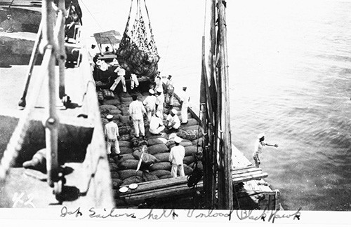 NH 100371:   USS Blackhawk (AD-9).  Japanese sailors help unload the ship after her arrival in Tokyo Bay with relief supplies for victims of the Great Kanto Earthquake in September 1923.  NHHC Photograph Collection.