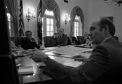 B0253-03A:   President Gerald R.  Ford and National Security Advisor Brent Scowcroft pointing to a map of Beirut, Lebanon, during the discussion of the evacuations, July 17, 1976.   Note Secretary of State Henry A.  Kissinger to the President's right.   White House Photographic Office Collection, now in the collections of the National Archives.