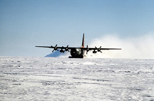 300-CFD-DN-ST-88-07037:   Spreading a wake of blowing snow, a ski-equipped LC-130 Hercules aircraft of Antarctic Development Squadron 6 (VXE-6) taxis for takeoff after leaving scientists at a remote camp during Operation Deep Freeze.   Photographed by JO2 Mike McKinley, 15 June 1988.     Official U.S. Navy photograph, now in the collections of the National Archives.