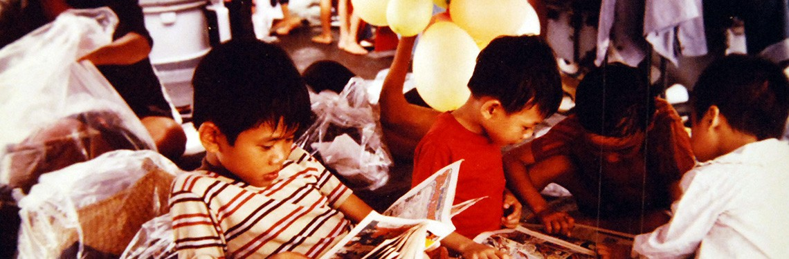 428-GX-K-130903:   South China Sea.  Vietnamese children relax and look at comic books on the deck of USS Towers (DDG-9), shortly after their rescue from a small boat found adrift.  Photographed by PH3 Kenneth Flemings, received May 3, 1981.      Official U.S. Navy Photograph, now in the collections of the National Archives.