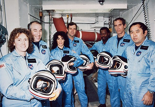 Space Shuttle Challenger (STS-51L) Crew (l-r): Payload Specialists Christa McAuliffe and Gregory B. Jarvis, Mission Specialist Judith A. Resnik, Commander Francis R. Scobee, Mission Specialist Ronald E. McNair, Pilot Michael J. Smith, Mission Specialist Ellison S. Onizuka.  NASA Photograph Collection.