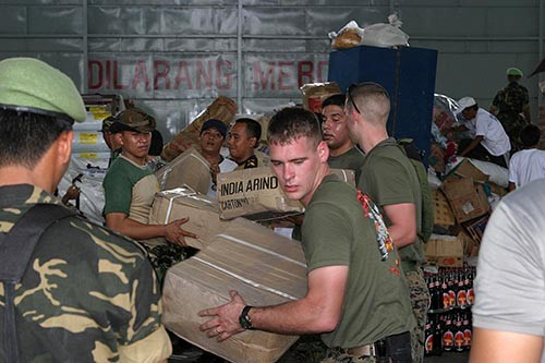 050104-M-9792P-027:   U.S. Marines work with Indonesian military personnel and international aid workers to sort and distribute humanitarian relief supplies stored in a warehouse at Palonia Air Field in Medan, Indonesia, January 4, 2005.    Photographed by Lance Cpl. Andreas A. Plaze.  Official U.S. Marine Corps photograph.