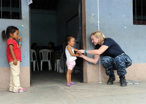 110701-T-EU-173-037:   Lieutenant Sara Edmonson talks with Guatemalan girl waiting to see a doctor during a Continuing Promise 2011 medical community service event in Puerto San Jose, Guatemala.   Photographed in July 2011 by Staff Sgt. Alesia Goosic.   Official Navy Photograph.