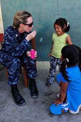 110506-F-NJ219-067:   Lieutenant Commander Michelle Carr blows bubbles for Peruvian children as they wait at a medical site during Continuing Promise 2011.   Photographed  in May 2011 by Sergeant Courtney Richardson.  Official U.S. Navy photograph.