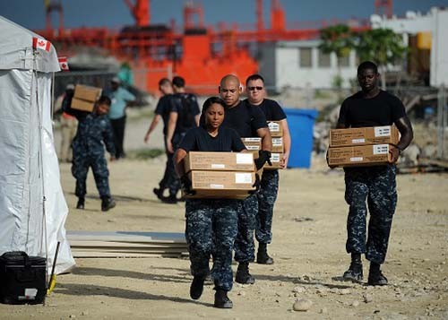 110821-N-NY820-119:  Sailors embarked onboard USNS Comfort (T-AH-20)  at Port-Au-Prince, Haiti, pack supplies during a site breakdown at the Terminal Verreux medical site in anticipation of severe weather from Hurricane Irene during Continuing Promise 2011.    Photographed on August 21, 2011 by MC2 Eric C. Tretter.   Official U.S. Navy Photograph.