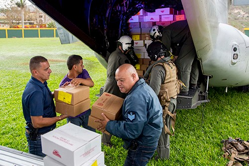170927-N-KW492-213:  Marines assigned to Marine Medium Tiltrotor Squadron 162, embarked aboard the amphibious assault ship USS Kearsarge (LHD 3), and local volunteers unload food from an MV-22 Osprey in Jayuya, Puerto Rico. Kearsarge is assisting with relief efforts in the aftermath of Hurricane Maria. Photographed on September 27, 2017 by Mass Communication Specialist 3rd Class Ryre Arciaga.  Official U.S. Navy photograph.