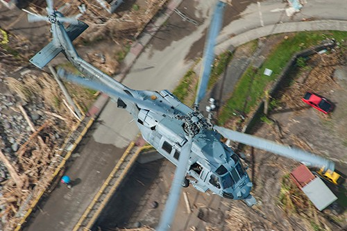 170925-N-NM806-0325:  An MH-60S Sea Hawk helicopter  flies over the island of Dominica during U.S. citizen evacuations and humanitarian relief following the landfall of Hurricane Maria. Photographed on September 25, 2017 by Mass Communication Specialist Seaman Taylor King.  Official U.S. Navy photograph.