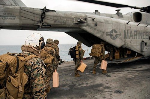 170922-N-AY374-003 :   Marines from the 26th Marine Expeditionary Unit board a CH-53E Super Stallion on the flight deck of the amphibious assault ship USS Kearsarge (LHD 3). Kearsarge and the 26th MEU are assisting with relief efforts in the aftermath of Hurricane Maria.   Photographed on September 22, 2017 by (Mass Communication Specialist 3rd Class Jacob Goff.  Official U.S. Navy photograph.