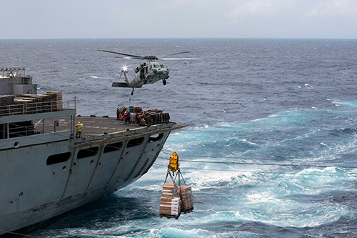 170928-N-KW492-392:  Pallets of supplies are transferred from the fast combat support ship USNS Supply (T-AOE 6) to the amphibious assault ship USS Kearsarge (LHD 3) during a replenishment-at-sea for continuing operations in Puerto Rico. Kearsarge is assisting with relief efforts in the aftermath of Hurricane Maria. Photographed on September 28, 2017 by (Mass Communication Specialist 3rd Class Ryre Arciaga.  Official U.S. Navy photograph.