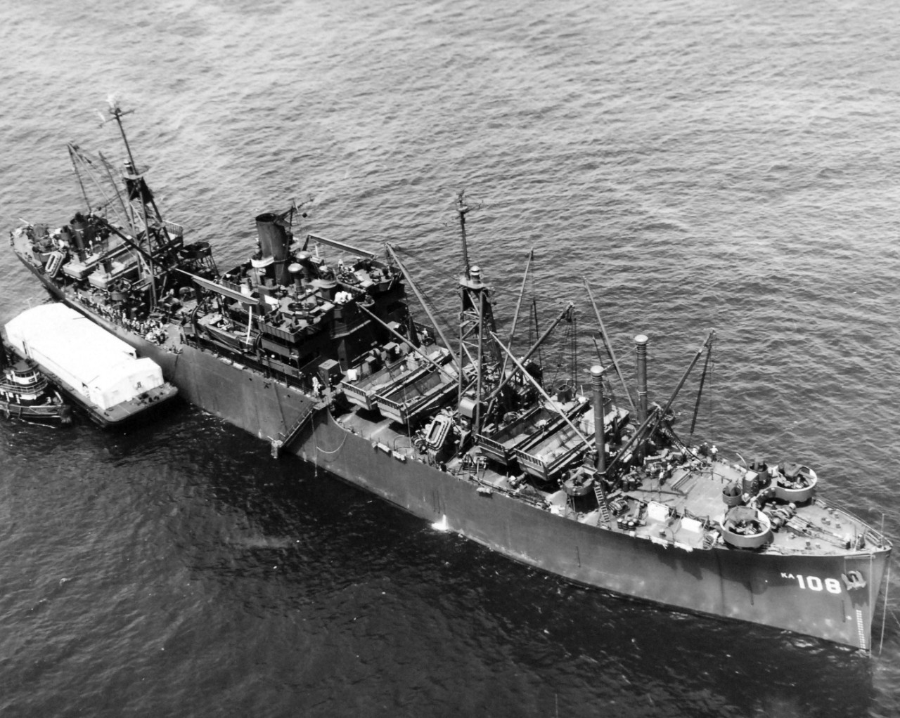 80-G-324142:  USS Washburn (AKA-108), May 1945.  Aerial at 300 feet.  Shown:  ¾ bow view.   Photographed by Floyd Bennett Field aircraft, May 21, 1945.  Official U.S. Navy Photograph, now in the collections of the National Archives.  (2017/11/22).  Note, photograph is curved.