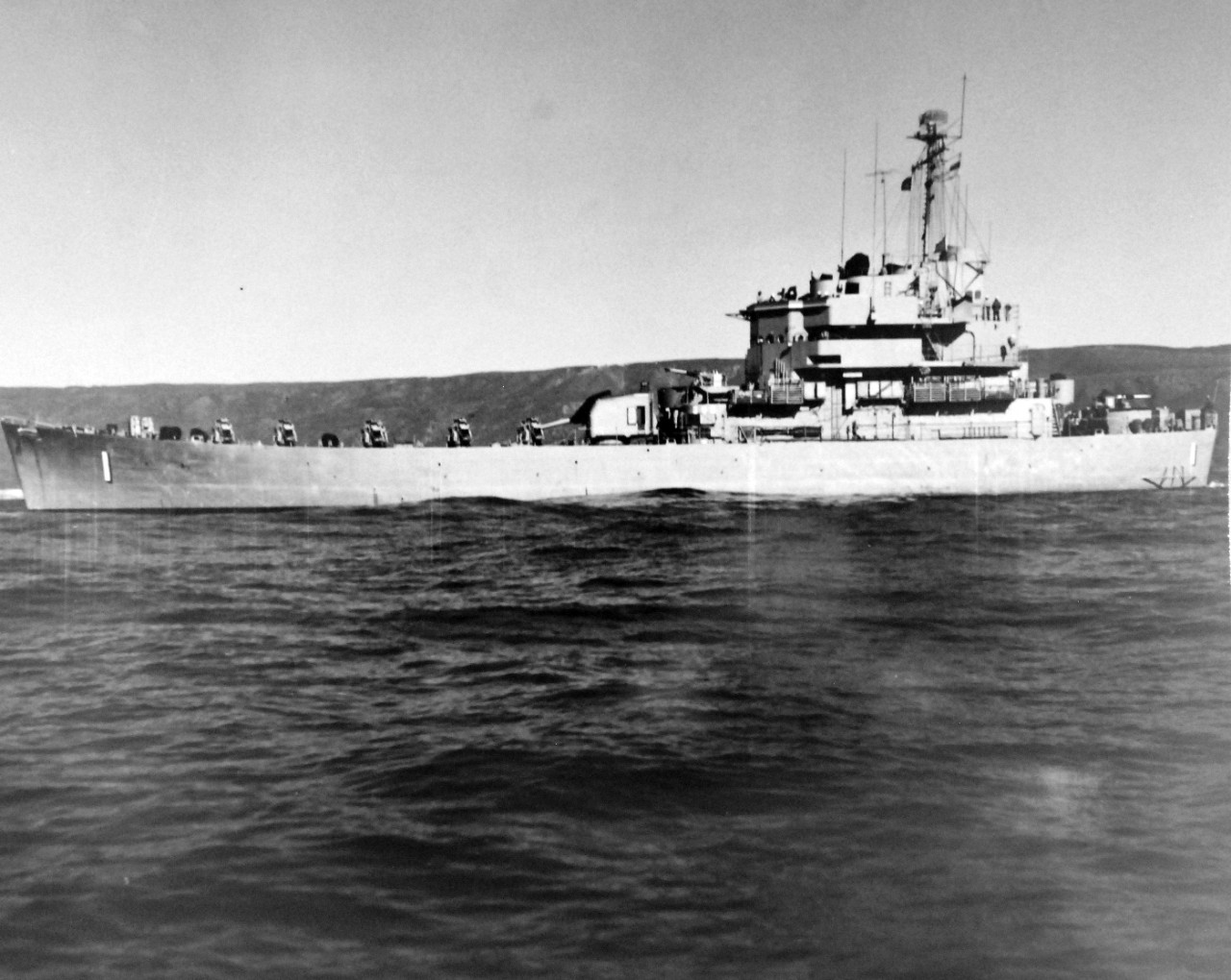 80-G-689754:  USS Carronade (IFS-1), 1955-59.   Carronade was an Inshore Fire Support Ship, built to provide gunfire support to amphibious landings or operations close to shore. Official U.S. Navy Photograph, now in the collections of the National Archives.  (2017/11/01).  Photograph is extremely curved.
