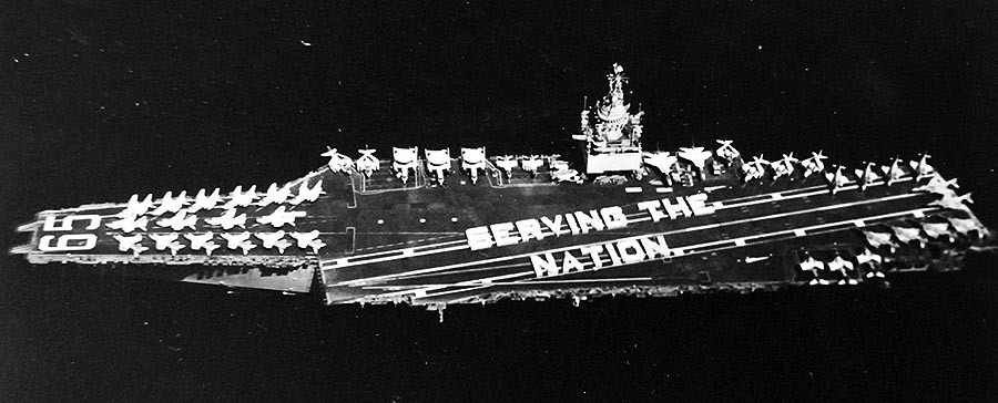 "428-GX-USN-1156107:   USS Enterprise (CVAN-65), 1973.  Crew of the nuclear-powered aircraft carrier and Attack Carrier Air Wing Fourteen form the words ""Serving the Nation"" on the flight deck.   Photographed by PH1 Ronald C. Bartel, May 19, 1973.   Official U.S. Navy Photograph, now in the collections of the National Archives.  (2017/11/29)."
