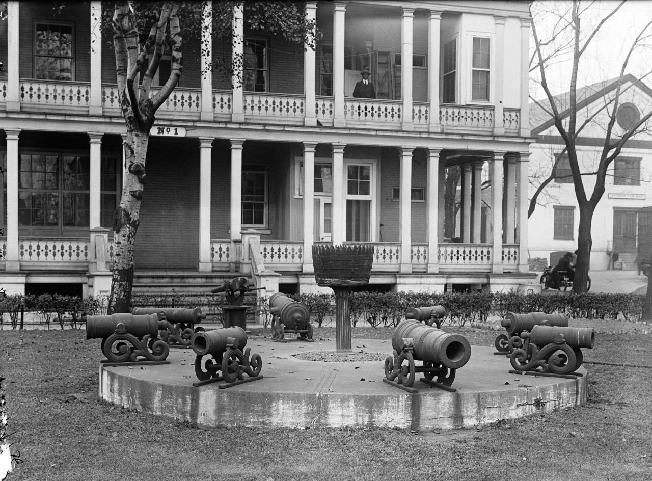 LC-DIG-HEC-10043:  Building 1, Washington Navy Yard, 1917.    Cannon and targets on the lawn before Building No.1, now Commandant of the Washington Navy Yard Headquarters.   Photographed by Harris & Ewing, 1917.  Courtesy of the Library of Congress.