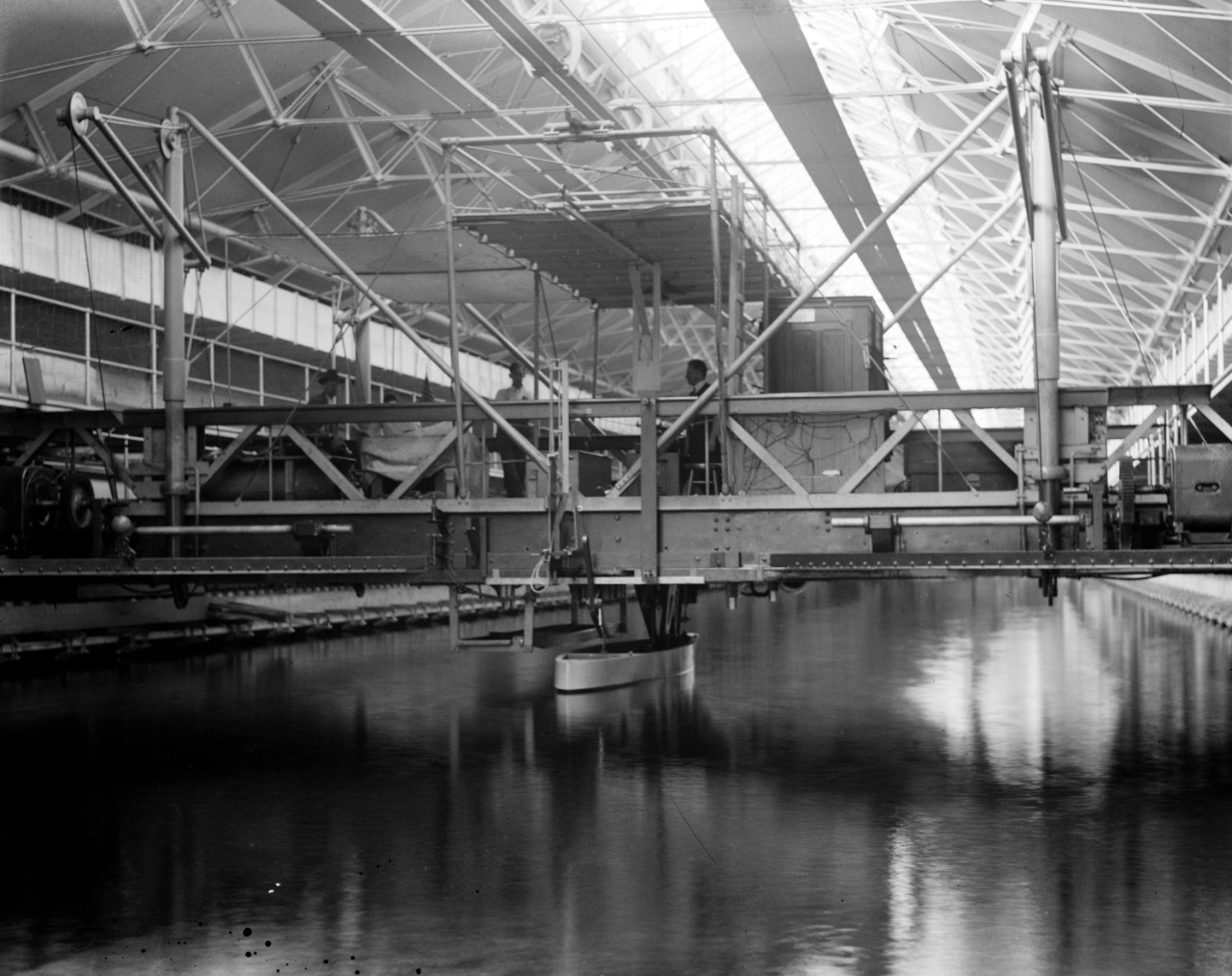 LC-DIG-NPCC-00823:  Experimental Model Basin, Washington Navy Yard, 1918.   Note man on platform.  The Model Basin is now the Cold War Gallery of the National Museum of the U.S. Navy.   Courtesy of the Library of Congress.