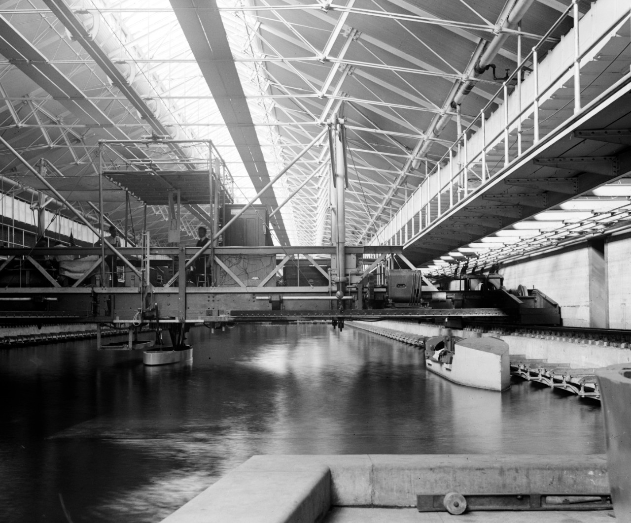 LC-DIG-NPCC-00824:  Experimental Model Basin, Washington Navy Yard, 1918.   Note man on platform.  The Model Basin is now the Cold War Gallery of the National Museum of the U.S. Navy.   Courtesy of the Library of Congress.