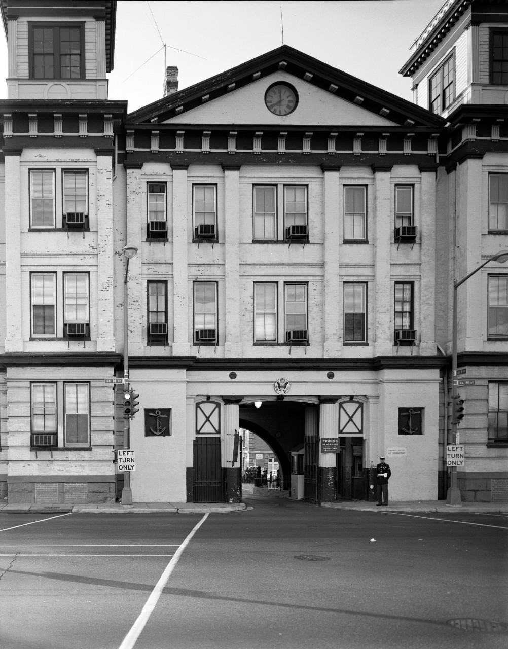 LC-DIG-HEC-030628:  Latrobe Gate, Washington Navy Yard, 1965.    Latrobe Gate and M Streets, Southeast, Washington, D.C., November 1965, Marc Blair of the Historic American Buildings Survey. Note, U.S. Marine standing guard.   Courtesy of the Library of Congress.