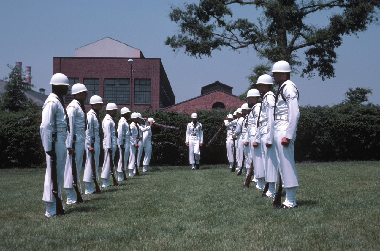 330-CFD-DN-ST-84-00585:  Leutze Park, Washington Navy Yard, 1984.   Members of the Ceremonial Guard Drill Team perform practice drills at their Washington Navy Yard headquarters.  Official U.S. Navy Photograph, now in the collections of the National Archives