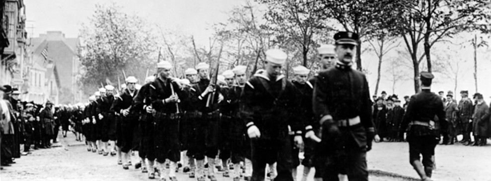 NH 114365:Sailors passing in review, celebrating first anniversary of America's entry into the war. St. Nazaire, France on April 5, 1918.