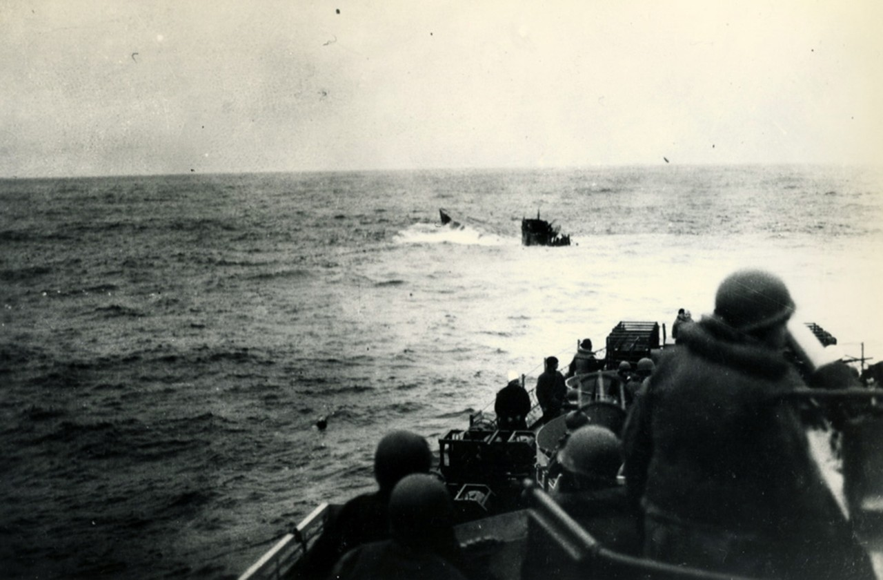 26-G-2552:   Sinking of German U-boats, 1944.    German (Type IXC) U-boat, U-550, surfaces astern of USS Joyce (DE 317) after being depth charged, April 16, 1944.  Joyce had a Coast Guard crew.  U.S. Coast Guard photograph now in the collections of the National Archives.