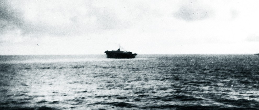 80-G-49302:   Loss of USS Block Island (CVE-21), May 29, 1944.   USS Block Island (CVE-21) sinking by the stern, after being torpedoed by U-549 in the Eastern Atlantic on 29 May 1944.   Official U.S. Navy Photograph, now in the collections of the National Archives.  (2017/07/18).