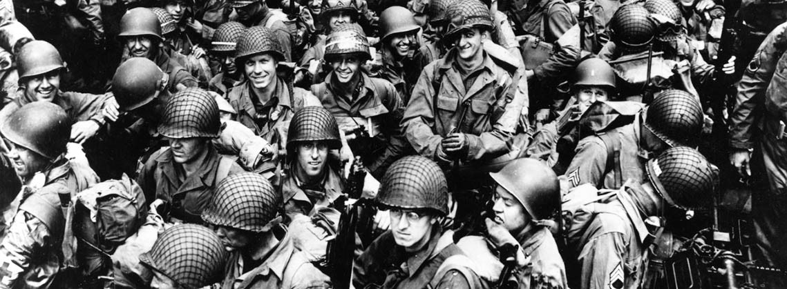 80-G-59422:   Normandy Invasion, June 1944.  Army troops on board a LCT, ready to ride across the English Channel to France. Some of these men wear 101st Airborne Division insignia. Photograph released 12 June 1944. Official U.S. Navy Photograph, now in the collections of the National Archives.