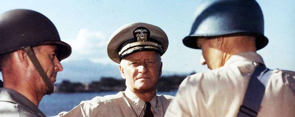 Image:   80-G-K-13796:  Commander-in-Chief Pacific Fleet and Pacific Ocean Areas Admiral Chester W. Nimitz, USN, converses with two officers onboard a Navy transport at Pearl Harbor, circa October 1943.   Official U.S. Navy Photograph, now in the collections of the National Archives.