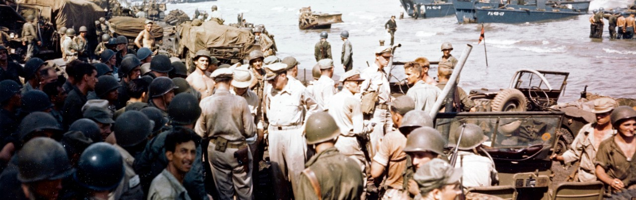 Image:  USA C-260:   Invasion of Leyte, October 20, 1944.   General Douglas MacArthur, (center), accompanied by his staff inspecting Leyte Island beachhead.   Official U.S. Navy Photograph, now in the collection of the National Archives.