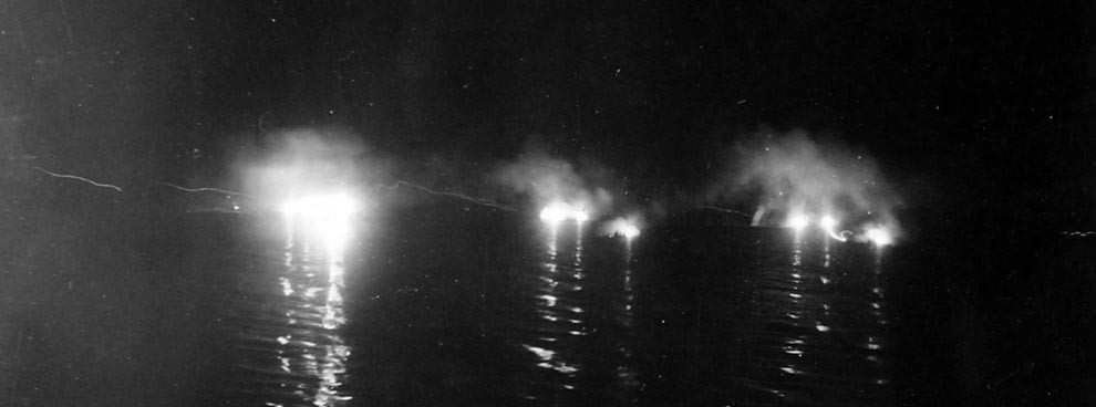 Image: 80-G-52817:  Battle of Kula Gulf, 5-6 July 1943.  Night-firing during the battle.    Official U.S. Navy Photograph, now in the collections of the National Archives.  (2018/04/04).