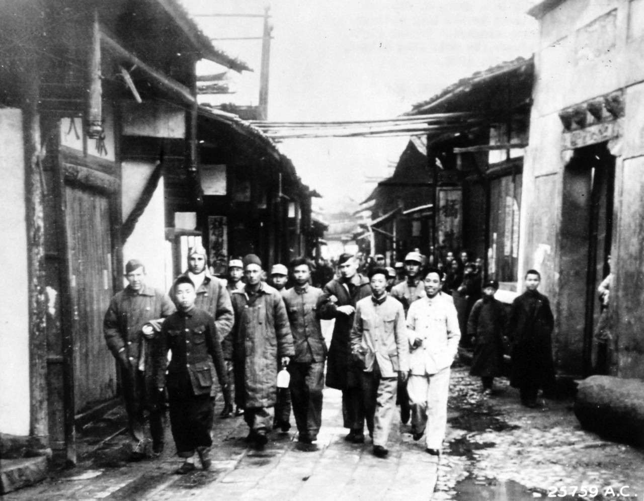 111-SC-A-25759AC-1:   Doolittle Raid on Japan, April 18, 1942.  Chinese soldiers bring in a group of General Doolittle's Tokyo Raiders to the tiny village near where their bomber crashed.  Center right, his arm held by a Chinese, is Colonel John Hilger, who was injured, April 21.    U.S. Army photograph, now in the collections of the National Archives.  (2017/05/02).