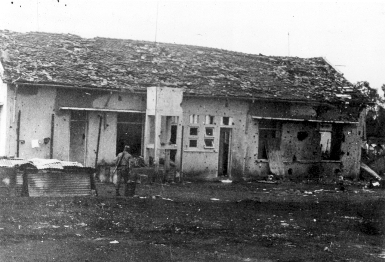 <p>Rear view of the District Headquarters Building at Dong Xoai, June 1965. The surviving American troops made their way to the District Headquarters Building but were quickly surrounded by an almost overwhelming Viet Cong.&nbsp;</p>