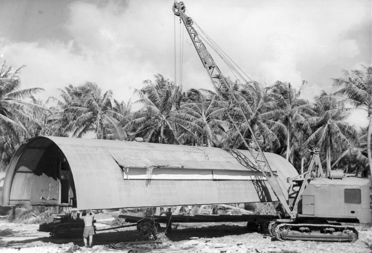 Placing the Quonset hut on a trailer bed, Majuro Atoll.