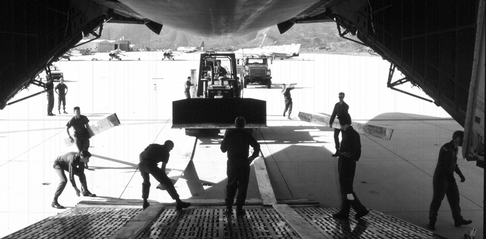 Seabees from Naval Mobile Construction Battalion Forty load up their equipment for their deployment to Mogadishu, Somalia, December 1992.