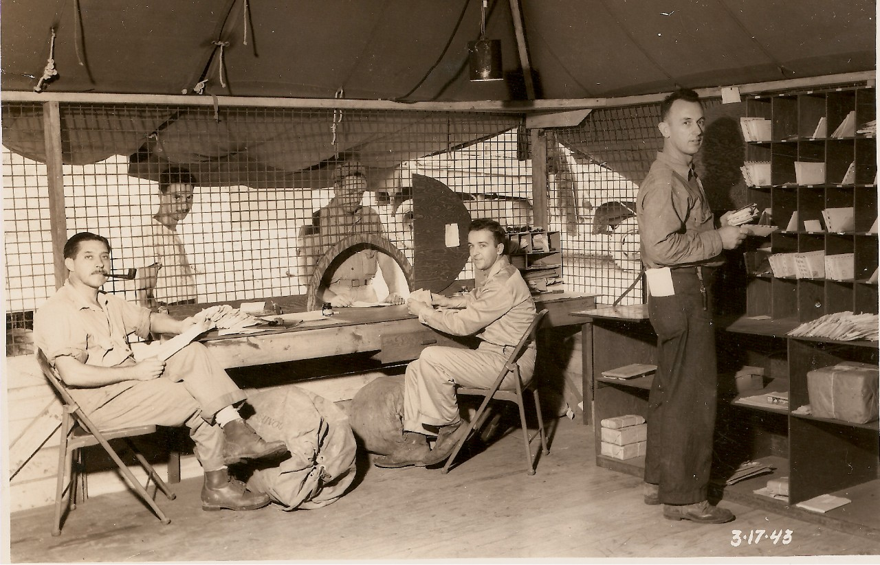 "<table border=""0"" cellpadding=""0"" cellspacing=""0"" width=""540""><tbody><tr><td height=""40"" width=""540"">Interior view of 7th NCB post office at Navy 8045, Espiritu Santo, New Hebrides</td></tr></tbody></table>"